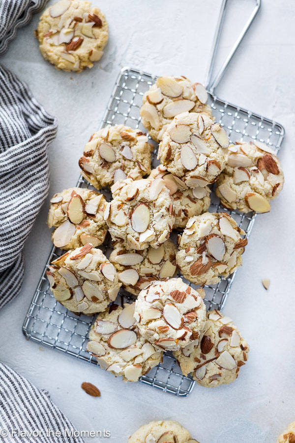 Greek Allmond Cookies piled on wire rack overhead shot