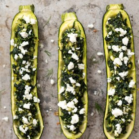 overhead shot of spanakopita stuffed zucchini boats on sheet pan