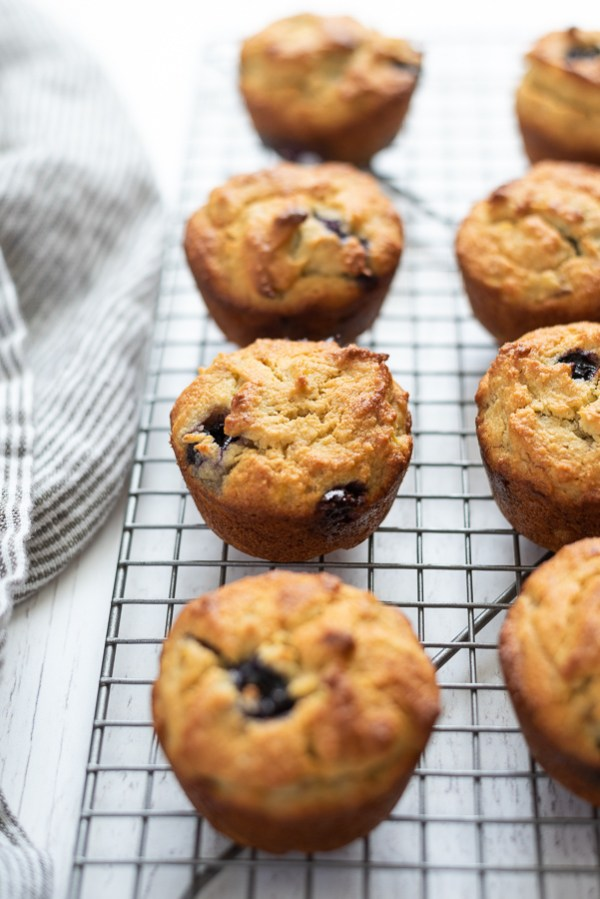 front view of almond flour blueberry banana muffins on a wire rack cooling