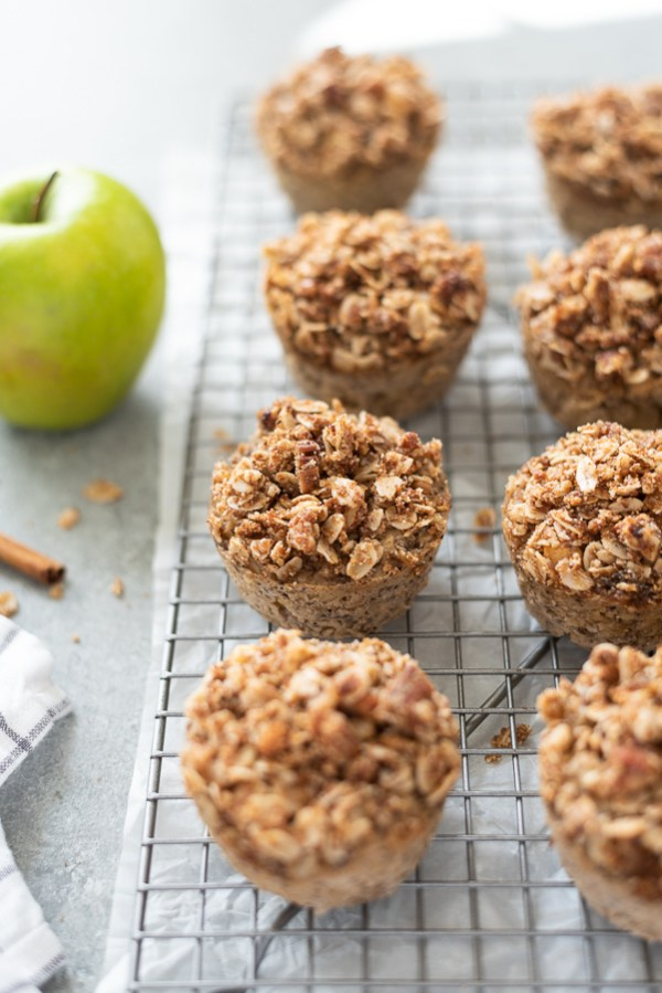 apple crisp baked oatmeal cups cooling on wire rack