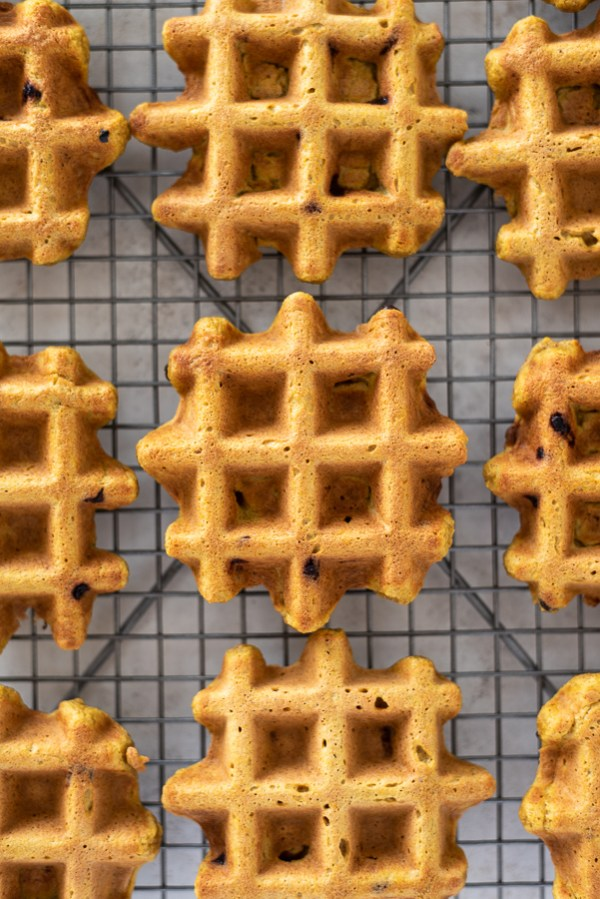 pumpkin oat flour waffles on a wire rack