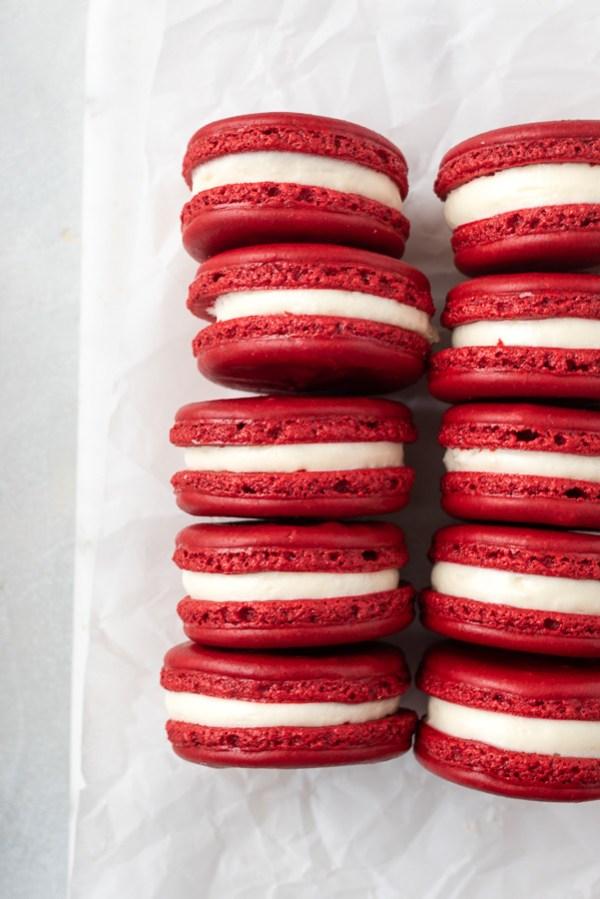 overhead shot of red velvet macarons lined up