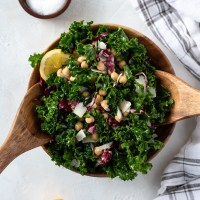 Massaged kale salad in bowl with chickpeas and parmesan