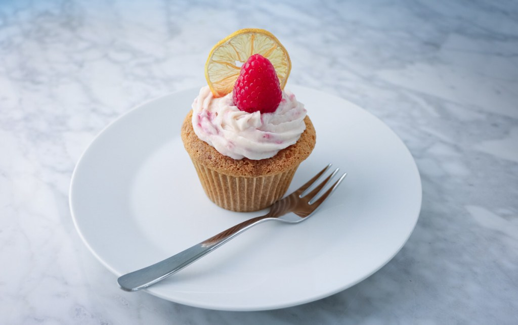 vanilla sponge cupcakes filled with lemon curd and raspberry mascarpone frosting