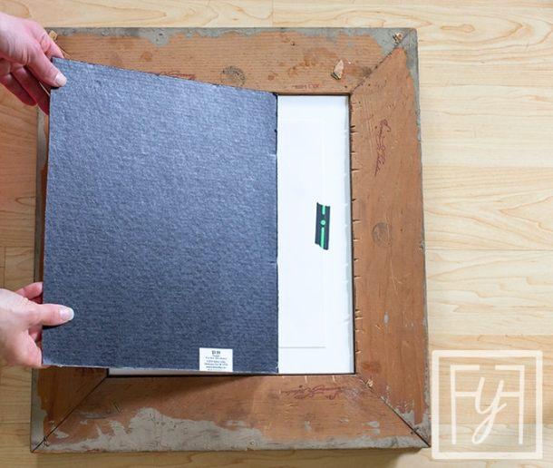 inserting cardboard backing into vintage frame