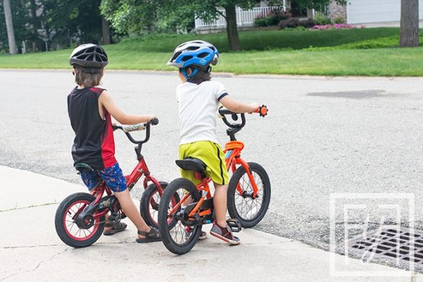 two boys on bikes healthy summer bucket list idea