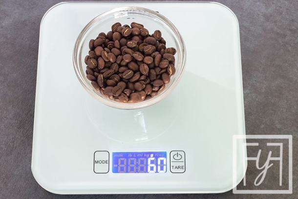 weighing coffee beans on scale for pour over coffee