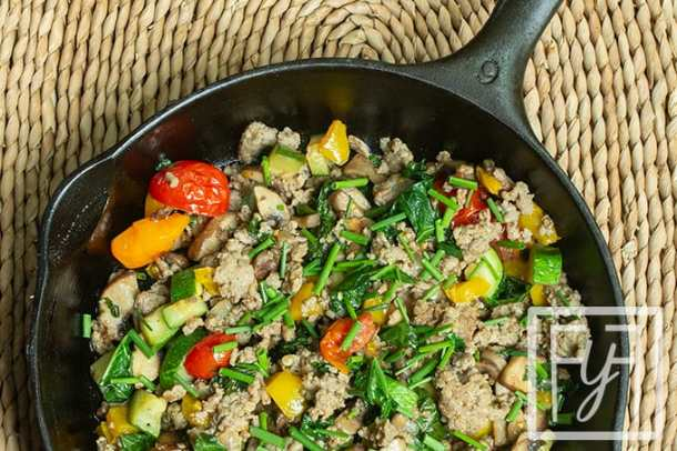 summer vegetable sausage hash in cast iron skillet