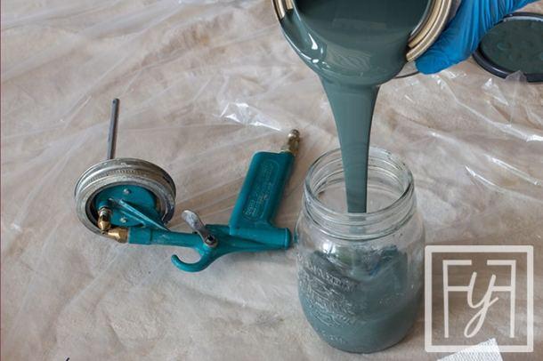 fill critter spray gun with paint