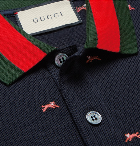 db25eac5724 For the last couple of seasons Gucci has embraced the animal kingdom  throughout their designs. The Gucci Panther-Embroidered Polo Shirt is a  rather fun but ...