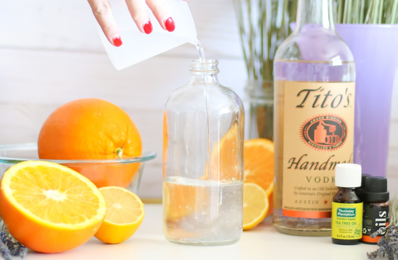 DIY essential oil linen spray by southern fashion blogger Stephanie Ziajka from Diary of a Debutante, DIY laundry spray with lavender, sweet orange, and tea tree oil from Thursday Plantation