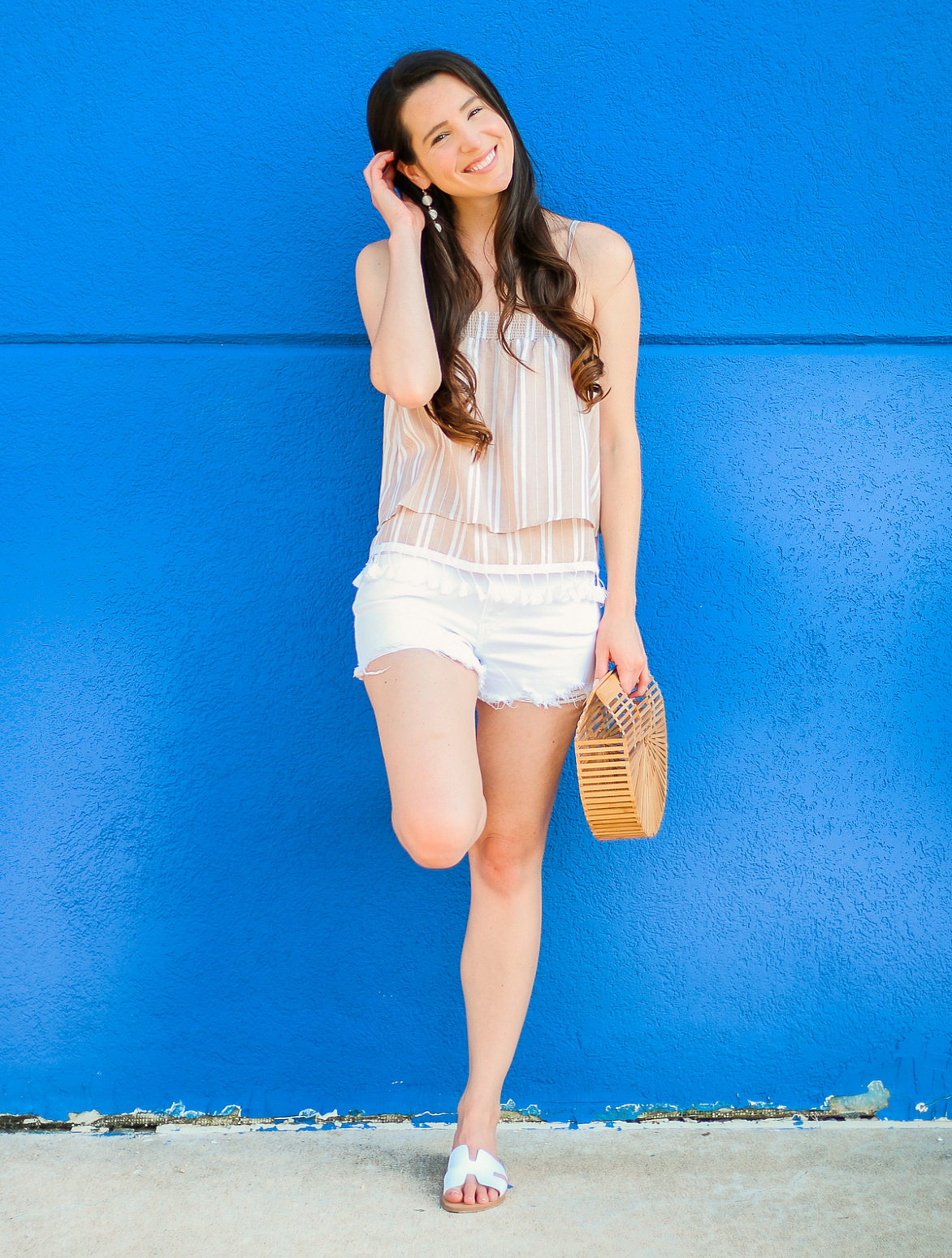 Why I Wear SPF Every Day (And Why You Should, Too) by beauty blogger Stephanie Ziajka from Diary of a Debutante, best daily face moisturizer with spf, Olay Total Effects Anti-Aging Moisturizer with SPF 15 review, Jack by BB Dakota Briella Top with Levi's 501 shorts, Madden Greece Slides, and a bamboo Cult Gaia dupe bag