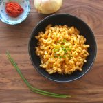 Photo of delicious Gluten-Free and Vegan Thai Curry Mac and Cheese with chives, red curry paste, and onion
