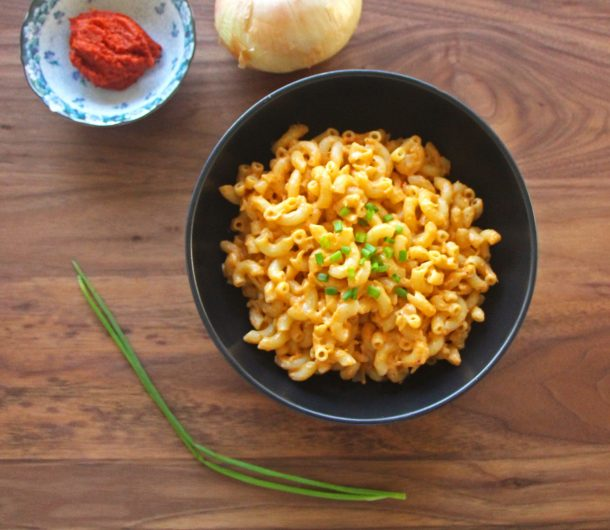 Photo of delicious Vegan Thai Curry Mac and Cheese with chives, red curry paste, and onion