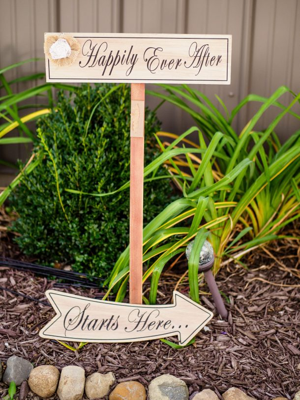 Photo of a sign that says happily ever after starts here