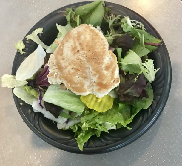 Gluten free salad at ABC Commissary in Hollywood Studios at Disney World. Order from the allergy friendly menu for a great gluten free quick service option!