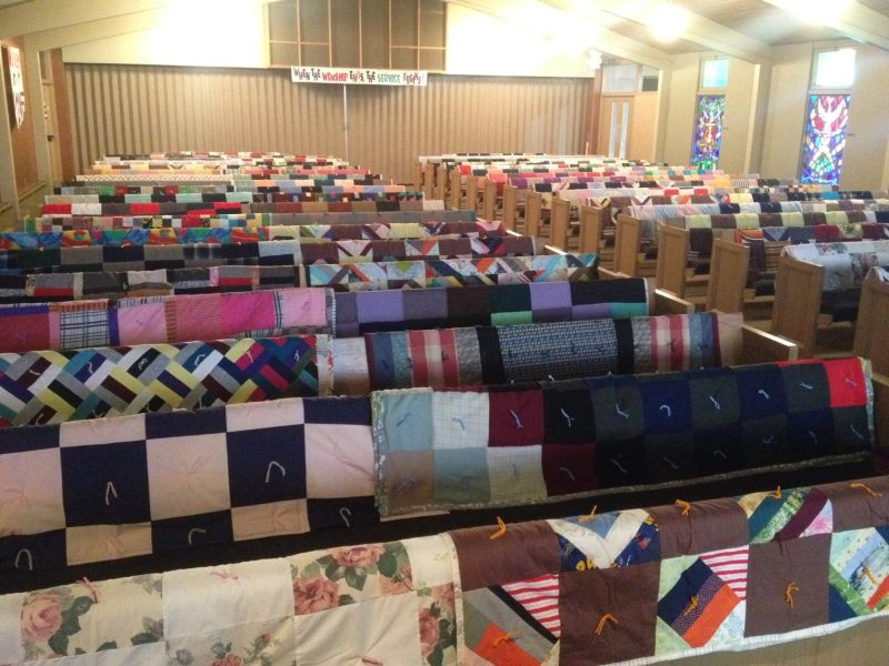 welca women's group quilts hanging on pews for blessing faith lutheran church bagley mn