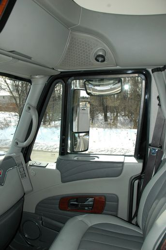 Compared to a more traditional arrangement, seen here, the monitor mounted to the A-pillar reduces the lateral blind spot created by the external mirror. - Photo: Jim Park