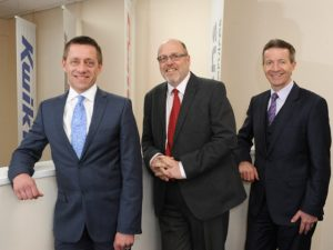 Andy Fern and Simon Lucas of Kwik Fit with outgoing fleet director Peter Lambert
