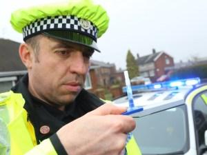 Police officer testing for drug driving