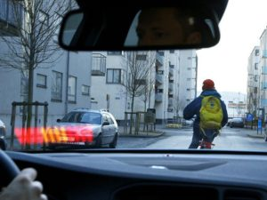 Car behind cyclist