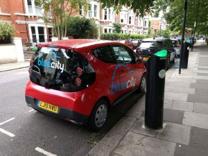 A Bluecity electric car sharing vehicle charging in London's Hammersmith and Fulham