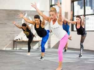 a woman leads a cardio workout