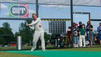 Shane Warne playing Cage Cricket