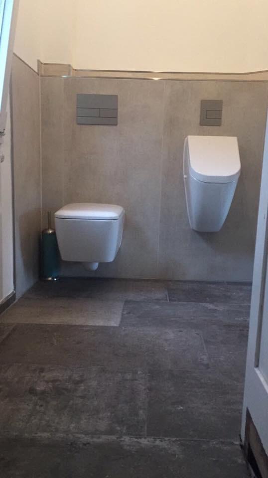 Badsanierung mit Bidet Urinal durch Fliesenleger Wilke in Solingen