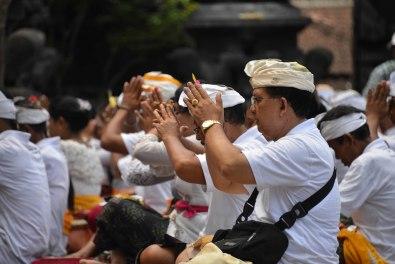 Balinese people praying at the temple