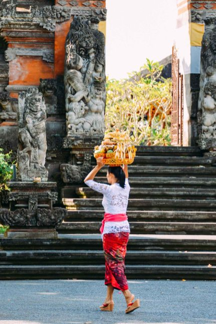 Balinese woman carrying offerings on her head on Galungan day 2014