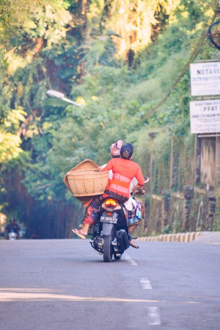 Balinese couple on a motorbike. Galungan 2014