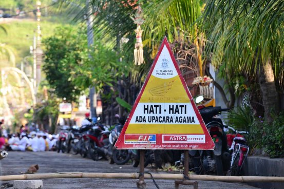 Hati Hati street sign, Kuningan Day, May31 Nusa Lembongan