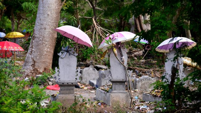 Festive Umbrellas in a cemetary in Nusa Lembongan, Bali