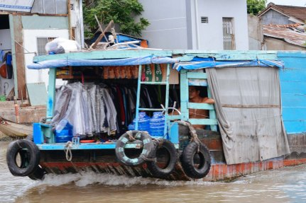 Pressed shirts on a boat on the mekong delta