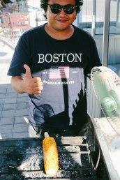 A vendor in Bali, wearing the Massachubatts shirt
