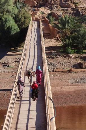 Locals crossing the bridge