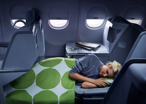 Finnair business woman sleeping 02 Low