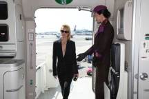 "Supermodel Amber Valletta welcomed by Etihad Airways cabin crew onboard the airline's ""NYFW: The Shows""-branded aircraft livery."