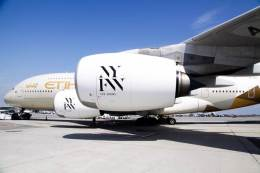 "Etihad Airways ""NYFW: The Shows""-branded A380 aircraft at JFK International Airport."