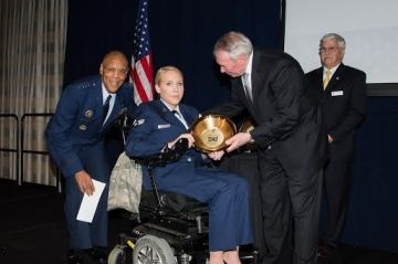 Senior Airman Taylor Renfro poses with her award with Gen. Larry Spencer. (Photo courtesy Meredith Resnick).