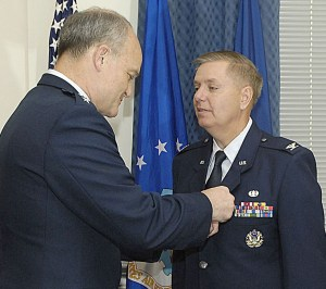 Lt. Gen. Jack L. Rives, Air Force judge advocate general, pins the Meritorious Service Medal on Col. Lindsey Graham in a Pentagon ceremony April 28, 2009. In addition to being a U.S. senator from South Carolina, Colonel Graham is an individual mobilization augmentee and the senior instructor at the Air Force JAG School at Maxwell Air Force Base, Ala. (U.S. Air Force photo)