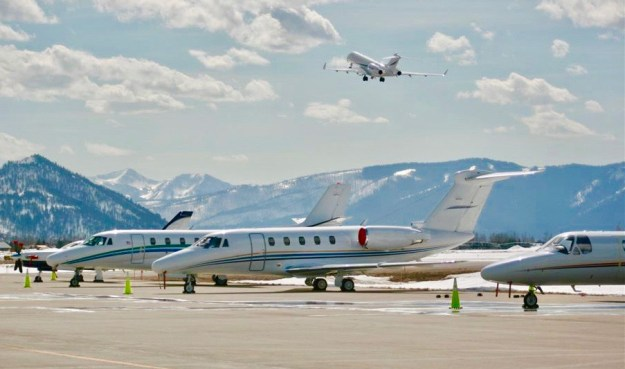 Photo: charter jets on ramp with large cabin charter flight departing