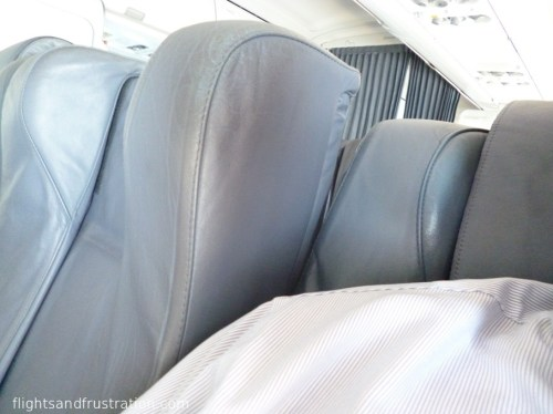 Reclining my seat meant rubbing my shoulder with the next seat