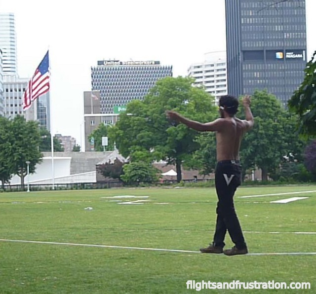 Performing slackline tricks at Pointe State Park Pittsburgh