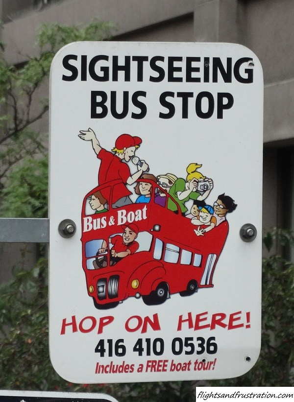 Bus stop sign for the Toronto Sightseeing Bus Tour of downtown Toronto attractions