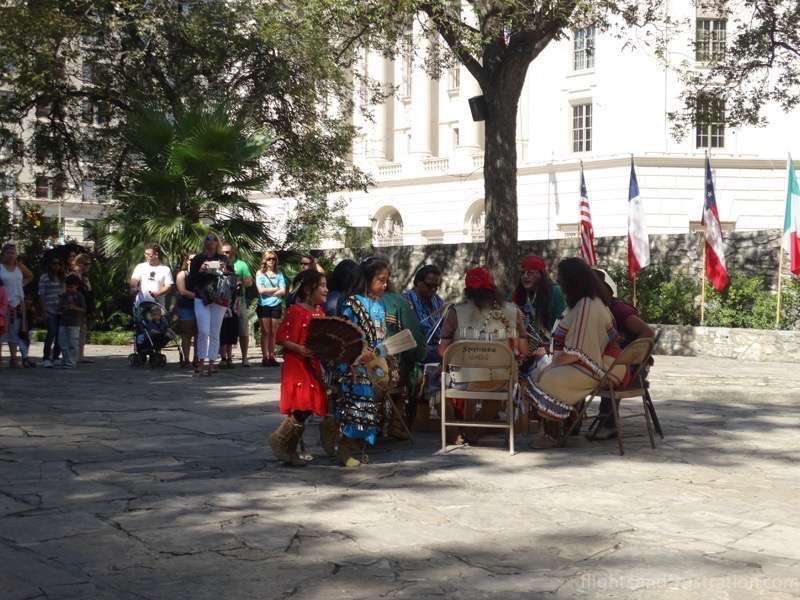 Indian children dancing outside The Alamo San Antonio Texas