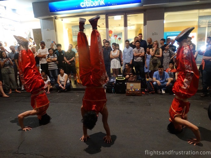Headstands and handstands in China town during the 2015 white night festival melbourne