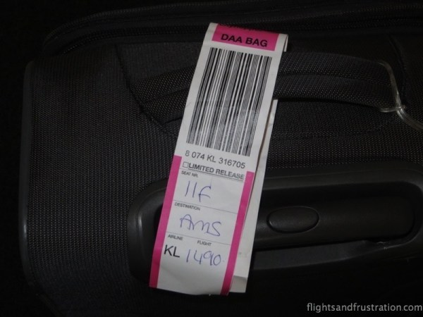 The pink label means that I have to concede my cabin bag with wheels when boarding