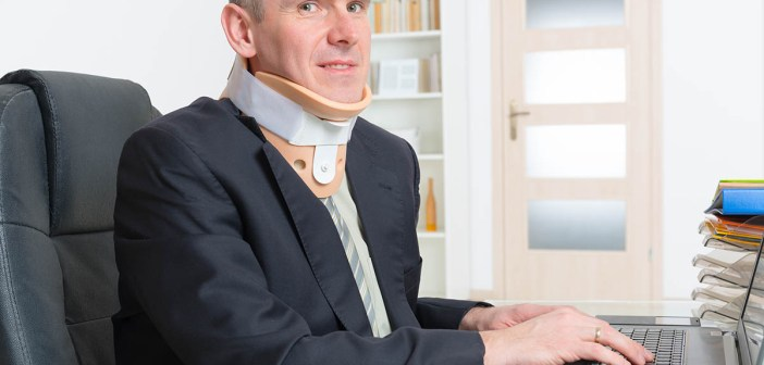 Man with a surgical cervical collar suffering from neck pain after car accident